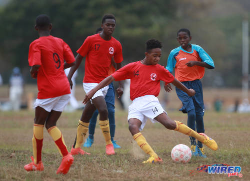 Photo: Trendsetter Hawks Under-15 attacker Josiah Edwards (second from right) takes a crack at goal during RBNYL action against Laventille United at the Queen's Park Savannah on 15 May 2017. Edwards, who is a National Under-15 player, treated himself to a few goals as Hawks won 11-1. (Courtesy Nicholas Bhajan/Wired868)