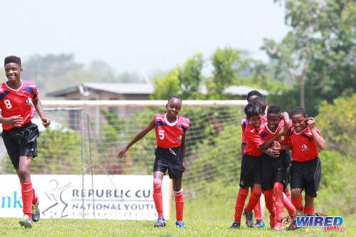 Photo: Petrotrin Palo Seco players celebrate a goal against Giving Back during RBNYL Under-13 action in La Brea on 21 May 2017. (Courtesy Allan V Crane/Wired868)