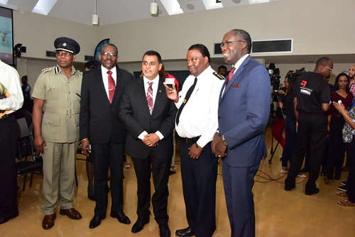 Photo: (From left) Stephen Williams (Acting Police Commissioner), Major General (Ret'd) Edmund Dillon (Minister of National Security), Rohan Sinanan (Minister of Works and Transport), Wayne Richards (Transport Commissioner) and Maxie Cuffie (Minister of Public Administration and Communications). (Copyright News.gov.tt)