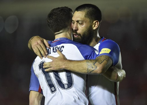 Photo: USA forward Clint Dempsey (right) celebrates with teammate Christian Pulisic after scoring against Panama during their 1-1 draw in 2018 World Cup qualifying action in Panama City on 28 March 2017. (Copyright AFP 2017/Rodrigo Arangua)