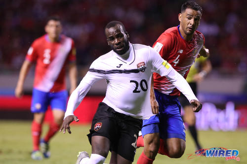 68adb6533 Photo  Trinidad and Tobago forward Jamille Boatswain (left) is hauled back  by Costa Rica defender Michael Umaña during 2018 World Cup qualifying  action at ...
