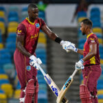 Pooran, Holder half-centuries help West Indies hold off Aussies and draw level at 1-1